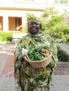 Flavors from Home Aimee Zaring Amina Osman  displaying fresh produce from her community garden