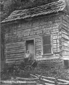 [James Still at the Amburgey cabin, 1983.] This log cabin on Dead Mare Branch near Hindman, Kentucky, was once the home of dulcimer maker Jethro Amburgey. In his will he bequeathed a lifetime habitation of the cabin to his lifelong friend, author James Still.